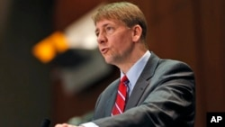 FILE - In this March 26, 2015, file photo, Consumer Financial Protection Bureau Director Richard Cordray speaks during a panel discussion in Richmond, Virginia. The Consumer Financial Protection Bureau has proposed a massive overhaul of the multibillion dollar debt-collection industry.