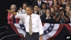 President Barack Obama points to the crowd following his speech at North Carolina State University in Raleigh, North Carolina, September 14, 2011.