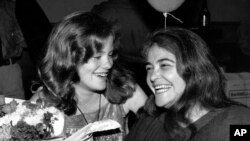 FILE - In this May 21, 1979 file photo, feminist activist Kate Millett, right, laughs, during a surprise birthday party for her niece, Kristan Vigard, in New York.