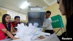 "FILE - Officials begin counting ballots after polls closed in Cambodia's general election, at a polling station in Phnom Penh, July 29, 2018. The spokeswoman for the U.S. State Department called the election ""neither free nor fair."""