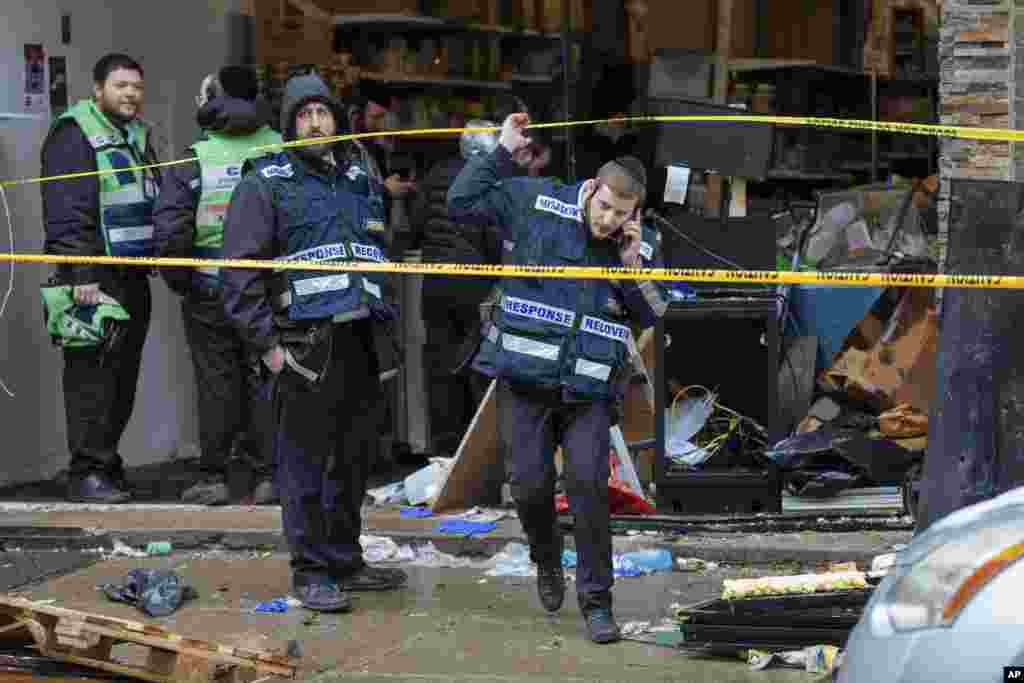 First responders work to clean up following Tuesday's shooting that left multiple people dead at a kosher market in Jersey City, New Jersey.