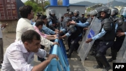 FILE - Pakistani police try to stop journalists during a rally to mark World Press Freedom Day in Islamabad on May 3, 2018.