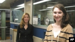 Janice and Arielle Schacter at one of the New York subway information booths which is equipped with a hearing loop.