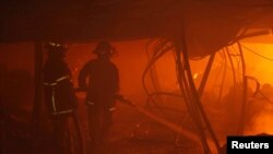 Firefighters try to control a fire inside a garment factory in Gazipur, Bangladesh, Oct. 9, 2013.