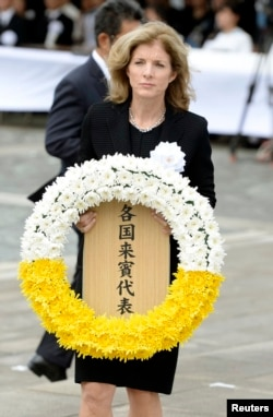 U.S. Ambassador to Japan Caroline Kennedy offers a wreath for victims of the 1945 atomic bombing in Nagasaki, in this Kyodo photo taken Aug. 9, 2014.