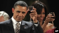 U.S. President Barack Obama and first lady Michelle Obama toast at the official dinner offered by Chile's President Sebastian Pinera at the government palace La Moneda in Santiago, Chile.