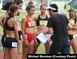 Tracktown star Alexi Pappas (center) speaks with director Jeremy Teicher during filming on location at historic Hayward Field in Eugene