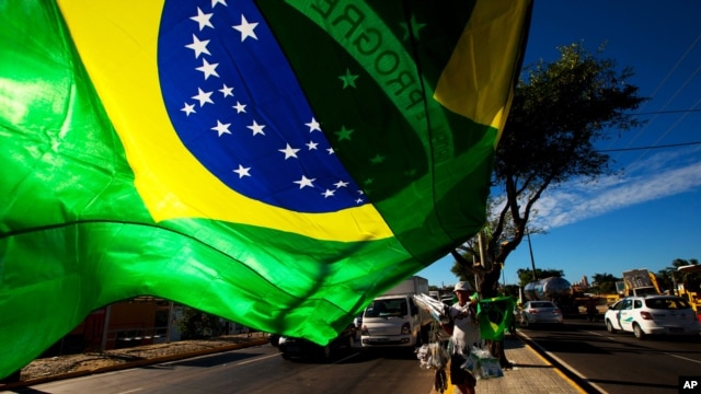 A street vendor sells representations of Brazil's national flags near the Arena Castelao in Fortaleza, Brazil, June 11, 2014.