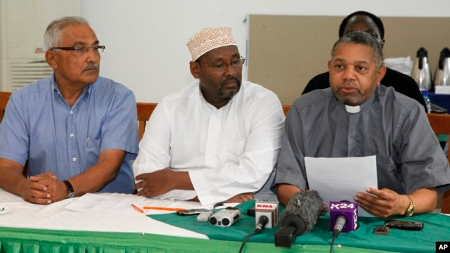 Supreme Council of Kenya Muslims secretary general Adan Wachu (C) is pictured in this August 30, 2012, file photo with Kishore Shah, of the Hindu Council of Kenya (L), and Fr. Wilybard Lagho, of the Coast Interfaith Council of Clerics, in Mombasa.