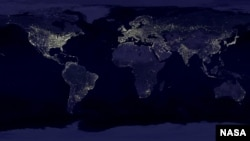 A satellite view of Earth showing the distribution of lights throughout the industrialized and developing worlds. This lighting overpowersbsdrowns out the night sky for the growing number of people who live in those areas. (NASA)