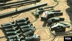 FILE - Weapons said to have been seized from separatist fighters are seen displayed in Bamenda, northwestern Cameroon, Feb. 6, 2019. (Moki Edwin Kindzeka/VOA)