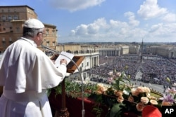 Pope Francis delivers his Urbi et Orbi (to the city and to the world) message from the main balcony of St. Peter's Basilica, at the Vatican, April 16, 2017.