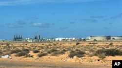 The oil refinery at Ras Lanouf last month when was still in rebel hands, March 5, 2011