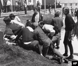 A Kent State University student lies on the ground after National Guardsman fired into a crowd of demonstrators on May 4, 1970 in Kent, Ohio. (AP Photo)