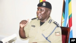 Police Spokesman Fred Enanga addressing a news Conference at the Police headquarters Monday, April 8, 2019. (AP Photo/Ronald Kabuubi)