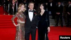 "(L to R) Lea Seydoux, Daniel Craig and Monica Bellucci pose for photographers as they attend the world premiere of the new James Bond 007 film ""Spectre"" at the Royal Albert Hall in London, Britain, October 26, 2015."