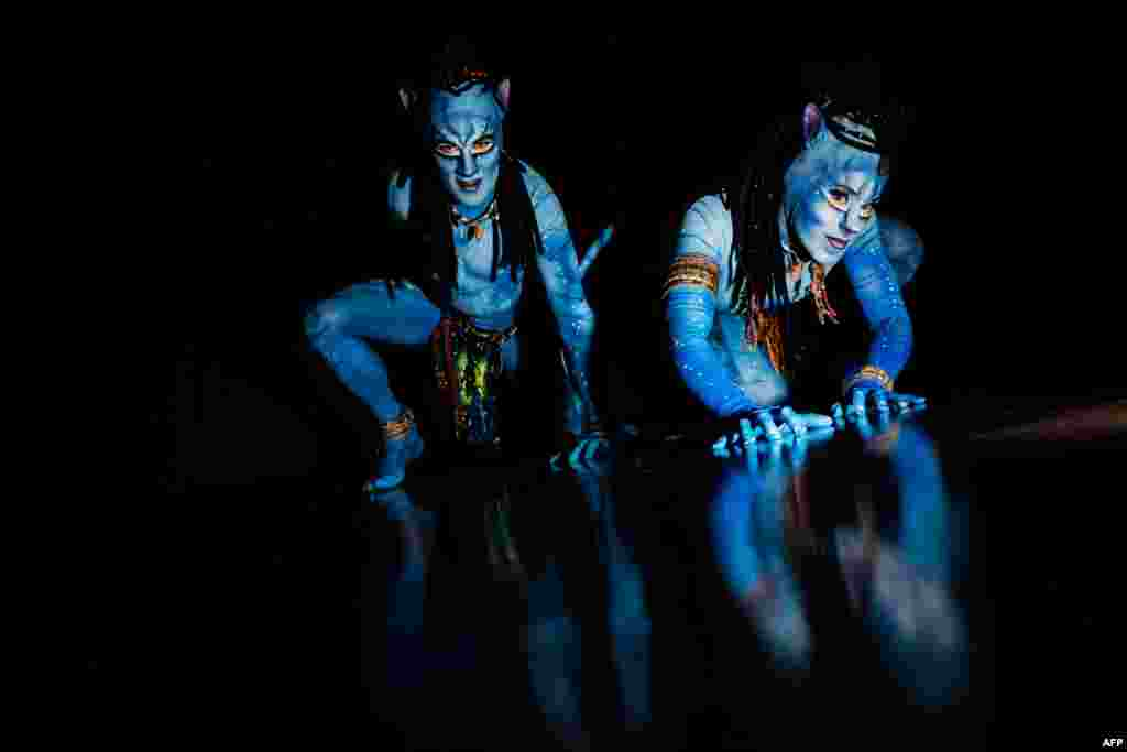"Artists pose before performing on stage in the Cirque du Soleil show called ""Toruk - The First Flight"" in Lyon Halle Tony Garner, France, Feb. 23, 2019. The show is inspired by James Cameron's film Avatar."