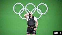 بهداد سلیمی وزنه بردار ایرانی که با رای هیات ژوری از کسب مدال ناکام ماند.