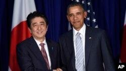 سەرۆک ئۆباما لەگەڵ شینزۆ ئابێ سەرۆک وەزیری ژاپـۆن (ئەرشیفی وێنە)