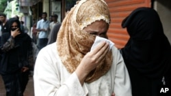 FILE - Raheen Memon, wife of Yakub Memon, reacts as she arrives at a special court trying cases of the 1993 Mumbai bombings that killed 257 people in Mumbai, India, July 27, 2007.