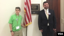 Caldoun Abuhakel and his 12-year-old son, Baraa, traveled to Washington, D.C., from Minnesota to take part in Muslim Advocacy Day, April 18, 2016. (C. Saine/VOA)