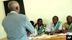 Boniface Kajyarugamba stands in front of a Gacaca court in Mayange, Rwanda, Thursday, Aug. 9, 2007 (file photo).