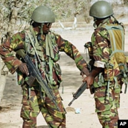 Kenyan soldiers talk as they prepare to advance near Liboi in Somalia (File)