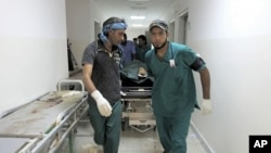 Body of a NTC fighter is wheeled into a hospital after an ambush by pro-Gaddafi forces in Ras Lanuf on September 12, 2011.