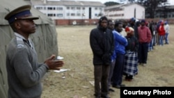 Voters waiting to cast their ballots outside a polling station in Harare recently.