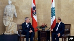 Lebanese President Michel Aoun, right, meets with his Austrian counterpart Alexander Van Der Bellen, at the Presidential Palace in Baabda, east of Beirut, Lebanon, Tuesday, Dec. 11, 2018.