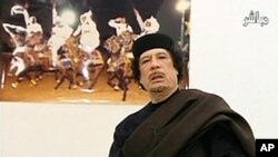 Muammar Gaddafi speaks at a Tripoli hotel in this still image from Libyan TV, released May 11, 2011