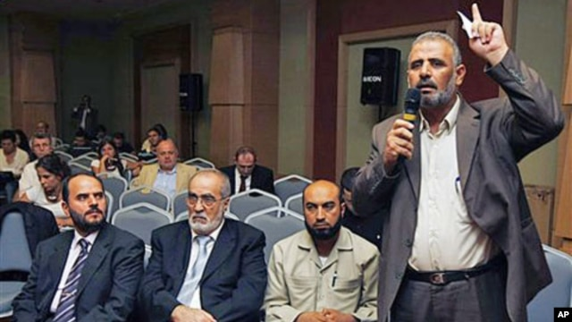 Jamal Al Wadi from the Syrian city of Daraa speaks as Syrian opposition members listen after they announced a Syrian National Council in their bid to present a united front against President Bashar al-Assad's regime, in Istanbul, Turkey, September 15, 201