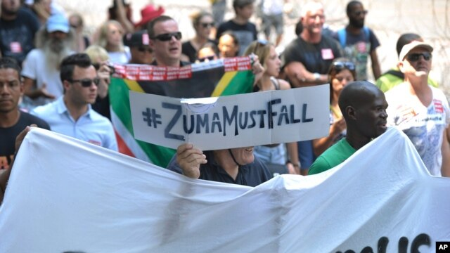 Protesters march near Parliament in Cape Town, South Africa, Feb. 11, 2016, calling for President Jacob Zuma to step down from power. Parliament opens later with Zuma delivering his state of the nation address to parliament.