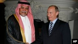 Russian Prime Minister Vladimir Putin greets Head of Saudi Arabia's National Security Council Prince Bandar bin Sultan during a meeting in Moscow, July 2008 file photo.