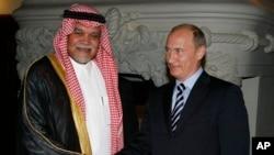 FILE - Russian Prime Minister Vladimir Putin greets Head of Saudi Arabia's National Security Council Prince Bandar bin Sultan.