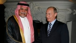 FILE - Russian Prime Minister Vladimir Putin greets Head of Saudi Arabia's National Security Council Prince Bandar bin Sultan.
