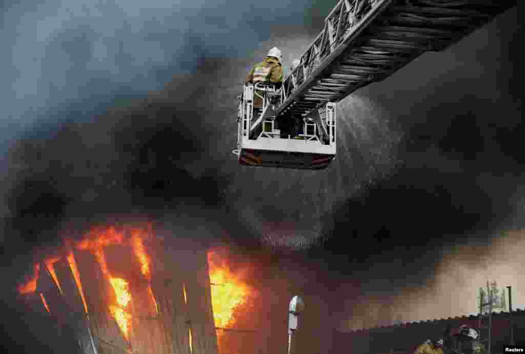 Firefighters work to extinguish a fire at a warehouse in Almaty, Kazakhstan.