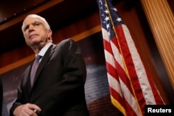 FILE - Senator John McCain looks on during a press conference.