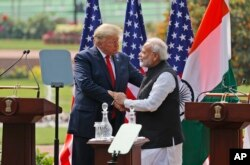 U.S. President Donald Trump and Indian Prime Minister Narendra Modi shake hands after giving a joint statement in New Delhi, India, Tuesday, Feb. 25, 2020.