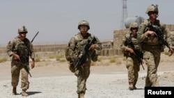 FILE - U.S. troops patrol at an Afghan National Army (ANA) Base in Logar province, Afghanistan, Aug. 7, 2018.