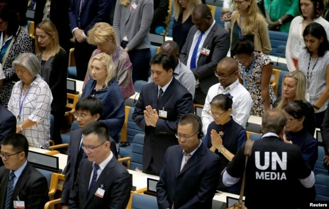 Delegates at the United Nations Environment Programme (UNEP) world environmental forum observe a minute's silence in memory of the victims of Ethiopian Airlines Flight ET 302 plane crash, at the UN complex within Gigiri in Nairobi, Kenya, March 11, 2019.