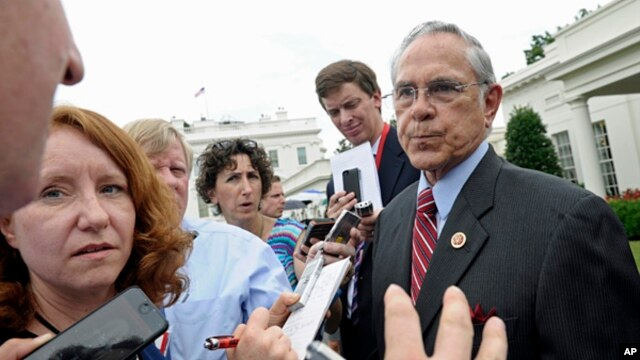 Rep. Ruben Hinojosa, speaks to reporters outside the White House, July 10, 2013, following a meeting between President Barack Obama and members of the Congressional Hispanic Caucus.