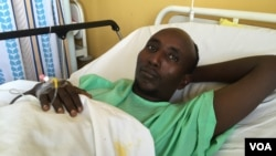 Salah Sabdow Farah was shot when the bus he was traveling in was attacked by al-Shabab militants in December 2015. He is recovering at Nairobi's Kenyatta National Hospital in January 2016.(J. Craig/VOA)
