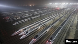 FILE - CRH380 (China Railway High-speed) Harmony bullet trains are seen at a high-speed train maintenance base in Wuhan, Hubei province, early December 25, 2012.