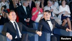 Vincent Aubin (L) and Bruno Boileau (R) react as they hold hands at their wedding ceremony at the city hall in Montpellier, May 29, 2013.