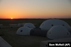 The sun rises over a 2.4-ton inflated structure used by the AMADEE-18 Mars simulation in the Dhofar desert of southern Oman.