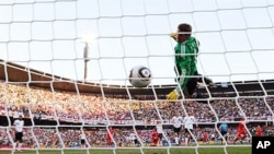 Germany's goalkeeper Manuel Neuer eyes the ball shot by England player Frank Lampard before goal was disallowed during 2010 World Cup round of 16 soccer match, 27 Jun 2010