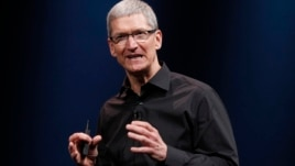 FILE - Apple CEO Tim Cook speaks during an Apple event in San Francisco, Sept. 12, 2012.