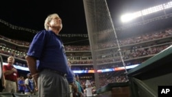 Former president George W. Bush is seen at a baseball game in Arlington, Texas, in this July 19, 2013, file photo.