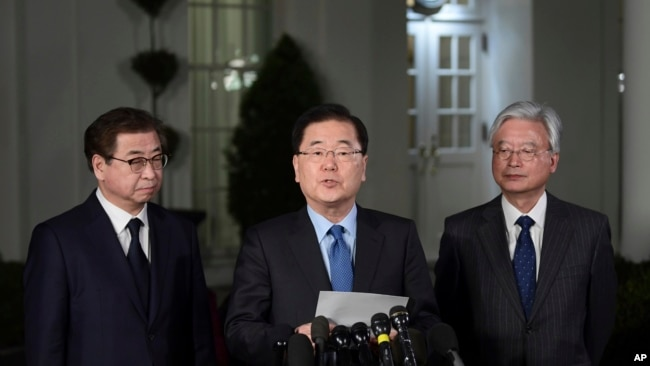 South Korean national security director Chung Eui-yong, center, speaks to reporters at the White House in Washington, March 8, 2018, as intelligence chief Suh Hoon, left and Cho Yoon-je, the South Korea ambassador to United States listen.